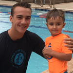 Coach Christian built Teddy's trust in the pool, and Teddy learned how to swim across the pool in just a few weeks.